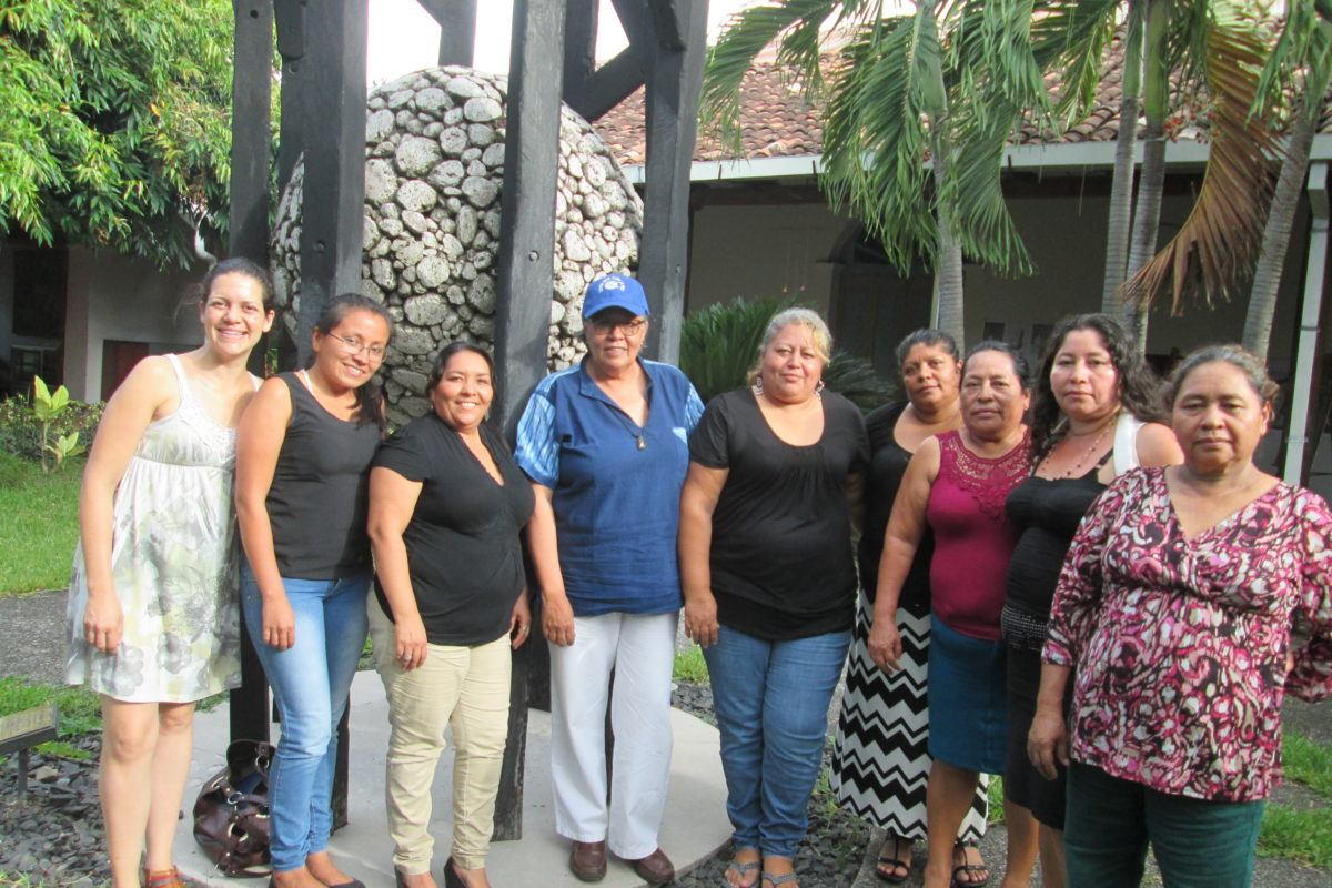 Photograph of ESPERA women standing outside with ESPERA staff.