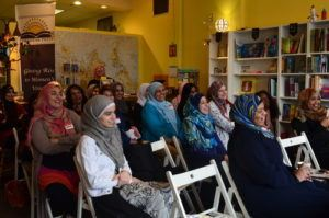 Audience seated at a bookstore in Minneapolis during RISE event.