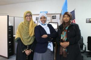 Three women in the office of Isuroon who champion health and civic engagement of their somali women and their communities in the Twin Cities.