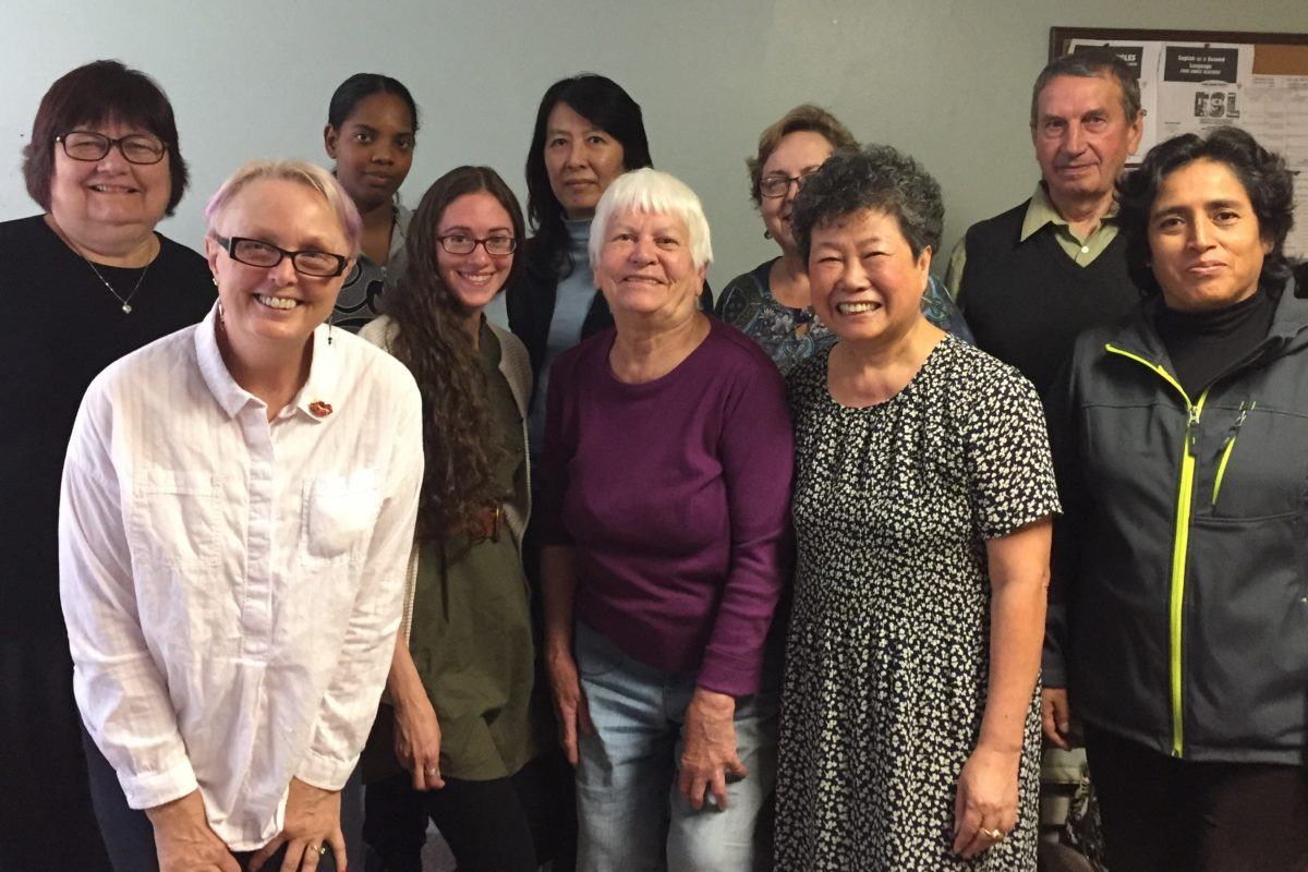 Photograph of the adult immigrant students in the Welcoming the stranger English Class.