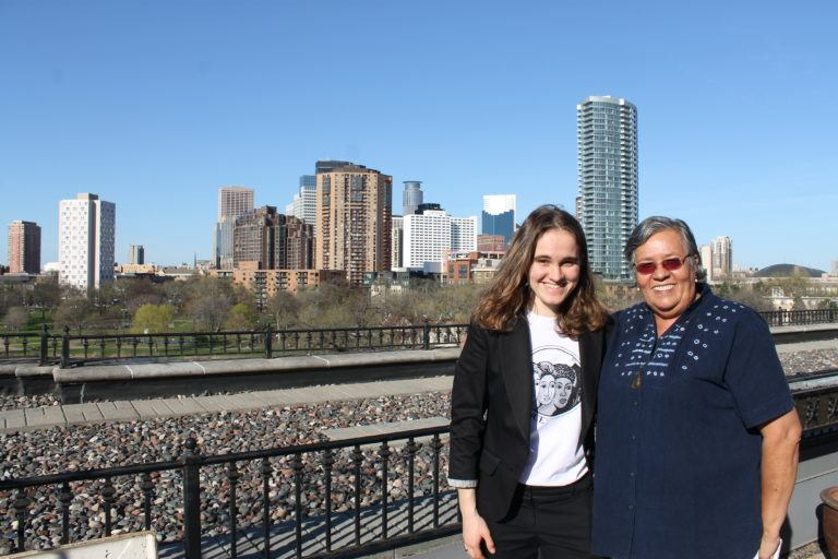 Photograph of Svitlana with Gilda with the Minneapolis Skyline in the background.