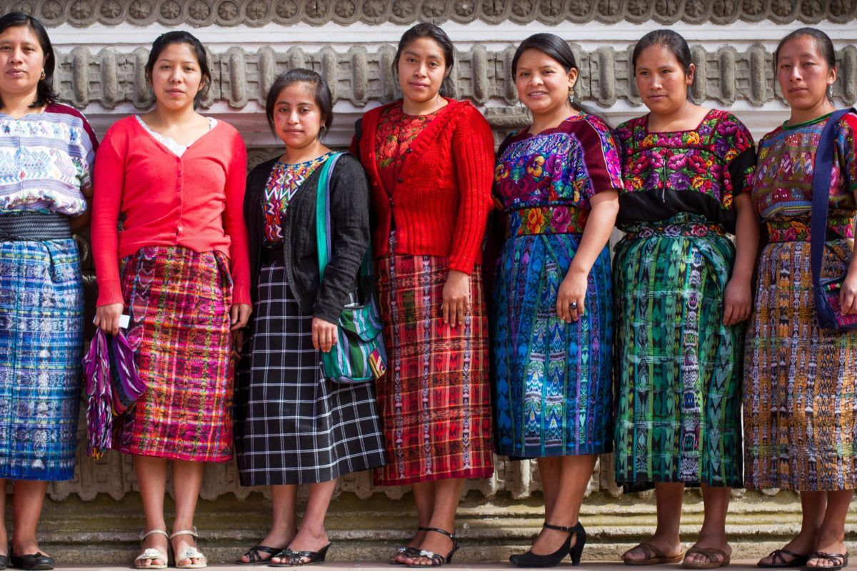 young women graduates from guatemala dressed in traditional bright patterned guatemalan dress