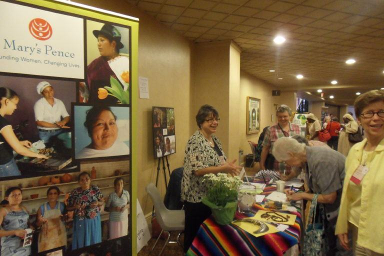 LCWR Assembly Attendees visiting the Mary's Pence exhibit booth