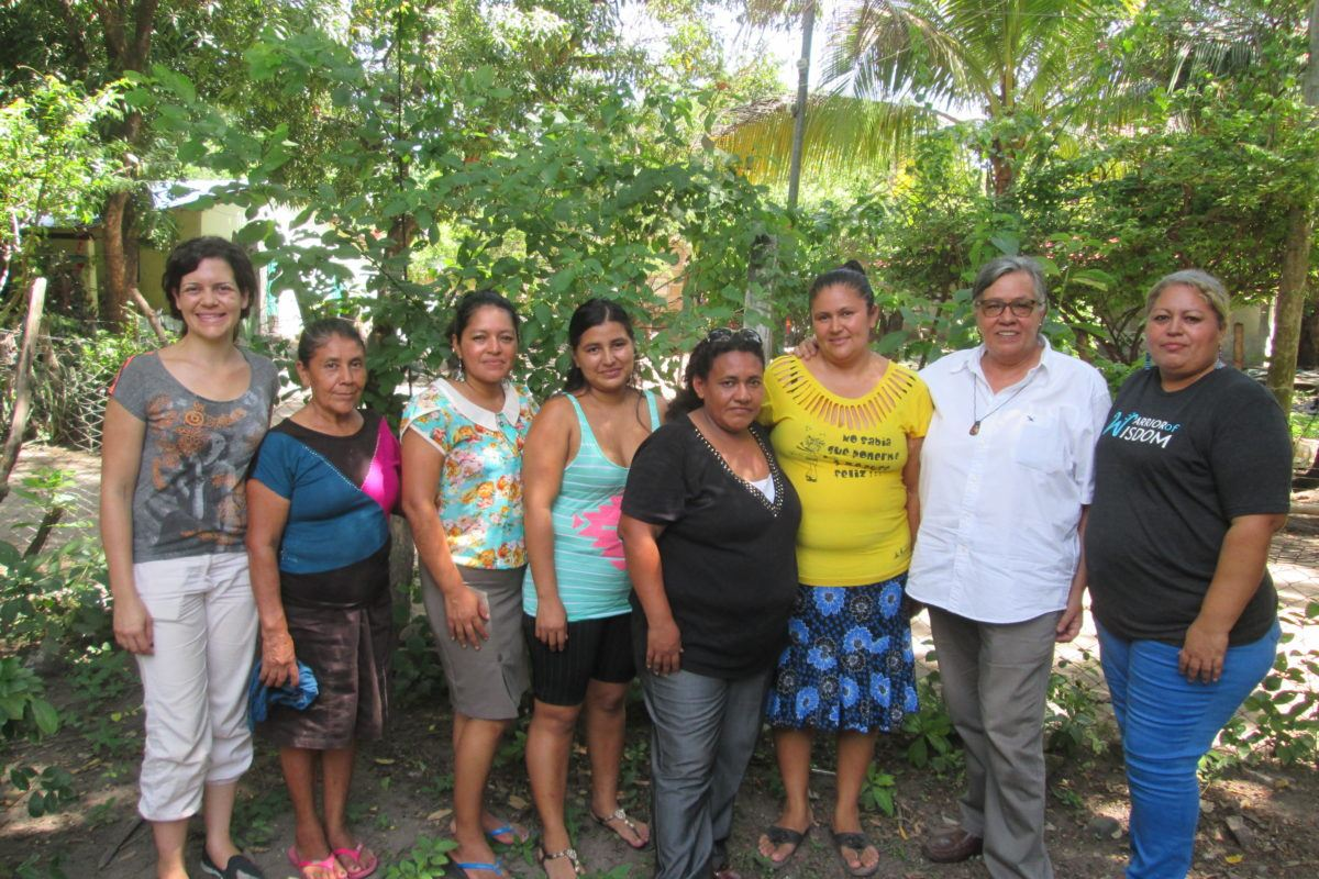 Group of women standing outside with ESPERA staff.