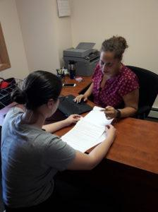 An Exodus Lending participant goes over financial documents with a staff person during a financial counseling visit.