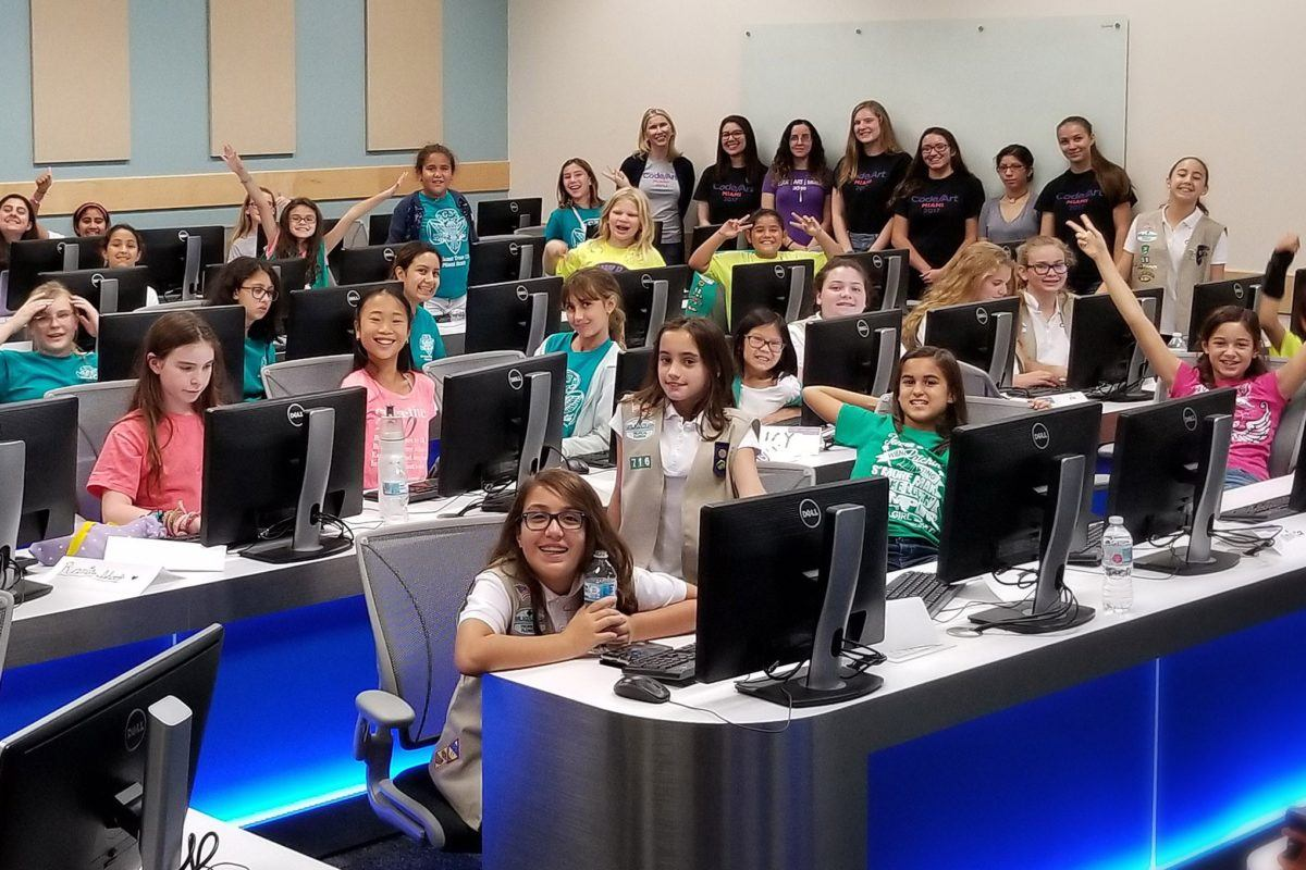Photo of about 30 middle-school aged girls in a computer lab.