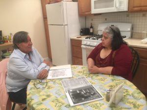 Gilda of ESPERA program and Maria Guadalupe of grantee CREA chatting at the kitchen table.