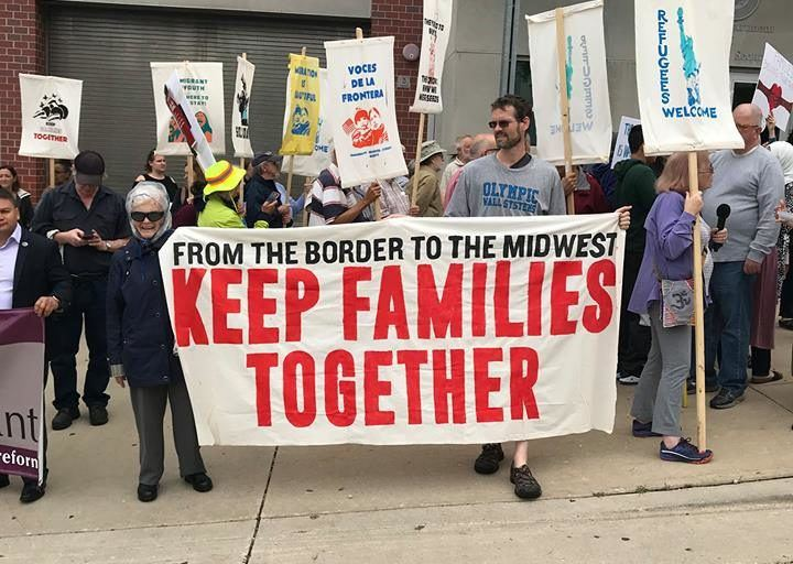 "Milwaukee New Sanctuary Movement with ""Keep Families Together"" sign"