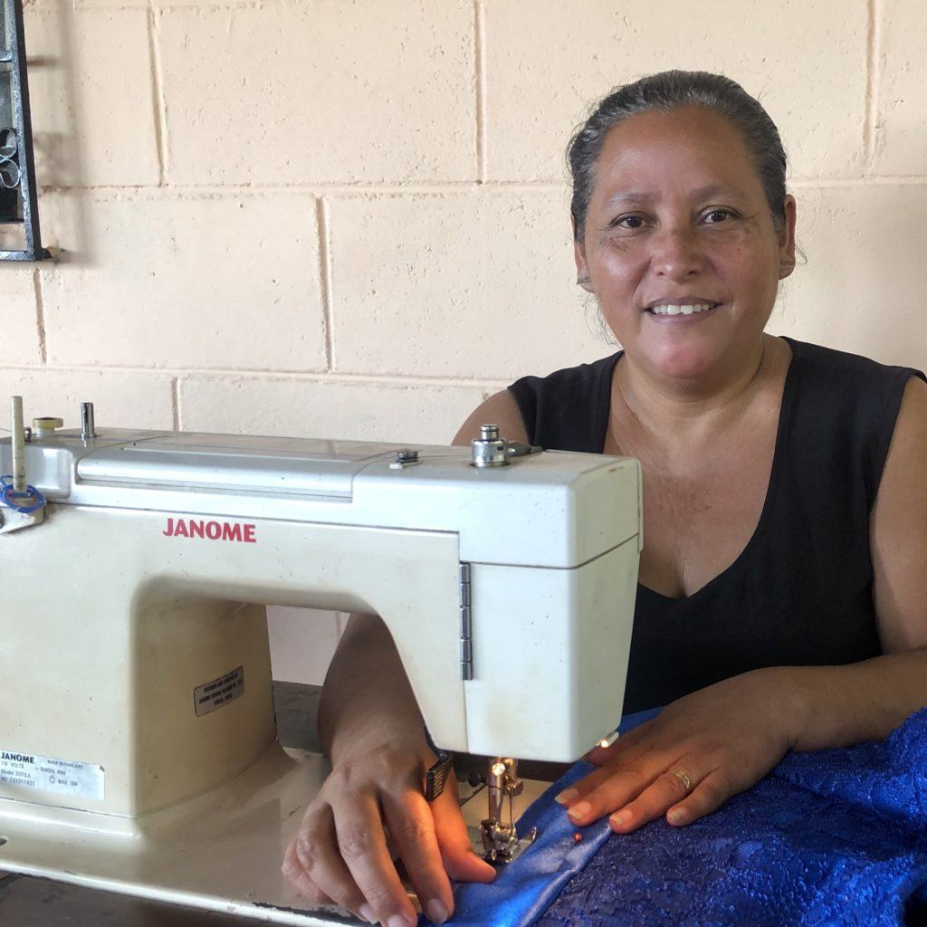 Editha at her sewing machine